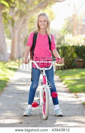 Girl Wearing Rucksack Cycling To School