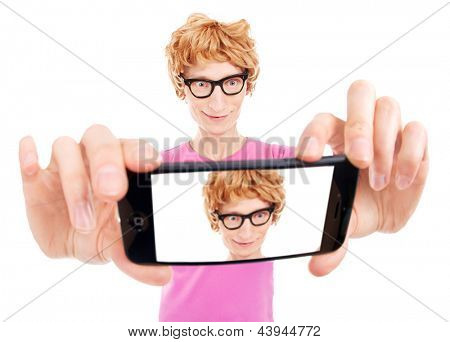 Funny nerdy guy is taking a self portrait with a smart phone