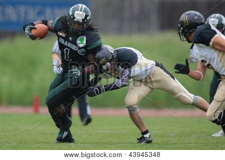 VIENNA, AUSTRIA - MAY 12:  RB Tunde Ogun (#1 Dragons) is tackled on May 12, 2012 in Vienna, Austria.