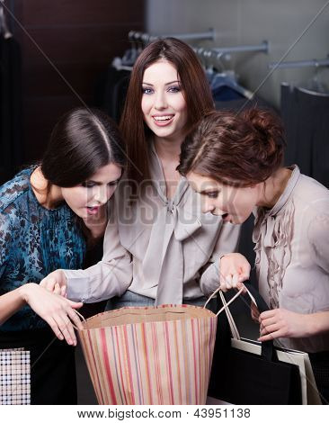 Girls wonder the purchases of their friend