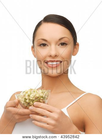 picture of healthy woman holding bowl with sprout