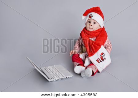 Baby Santa Claus With White Laptop