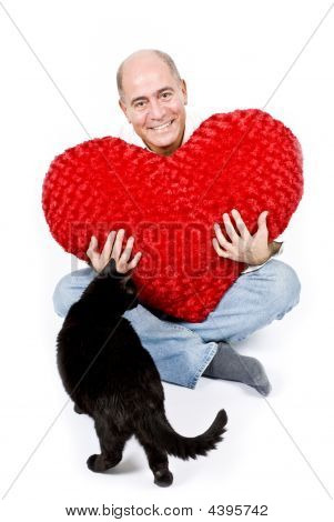 Latin Man With A Red Heart And A Black Cat
