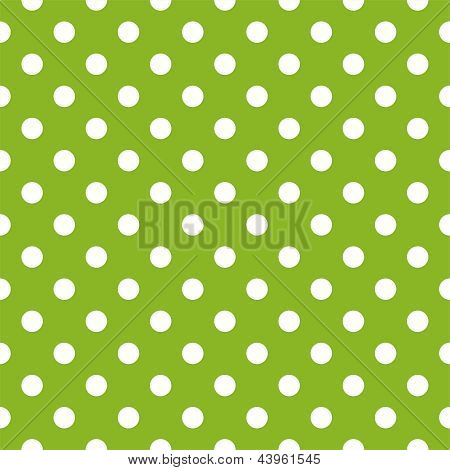 Seamless vector spring pattern with white polka dots on fresh grass green background