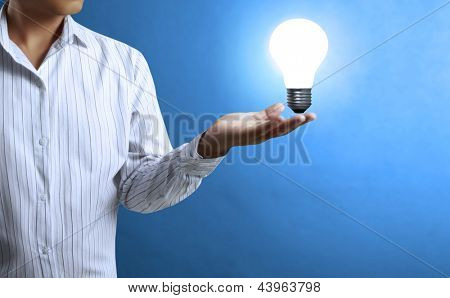 Light bulb, in a hand Business man