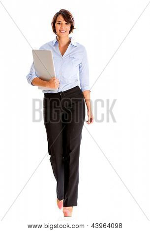 Business woman walking and carrying a laptop - isolated over white