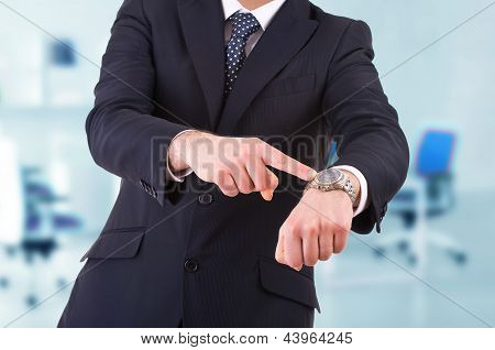 Business man pointing at his wrist watch.