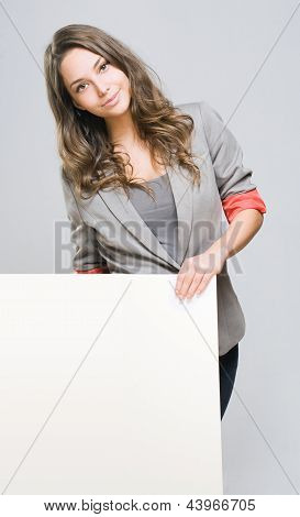 Beautiful Businesswoman With Blank White Sign.