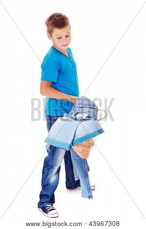 Boy catching denim clothes into his butterfly net