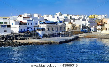 LA OLIVA, SPAIN - JUNE 26: View of El Cotillo on June 26, 2013 in La Oliva, Fuerteventura, Canary Islands, Spain. This charming small fishing village is famous for its excellent fish restaurants