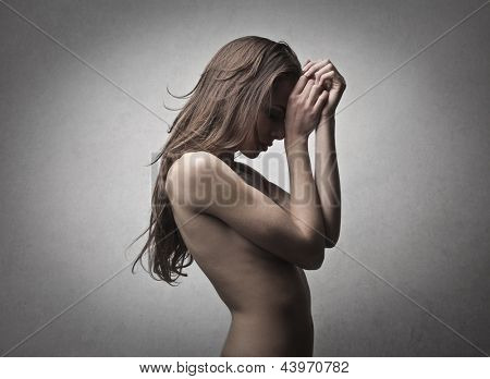beautiful naked woman covers her face
