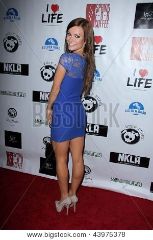 LOS ANGELES - APR 2:  Caitlin O'Connor arrives at  the No Kill L.A. Charity Event at the Fred Segal on April 2, 2013 in West Hollywood, CA