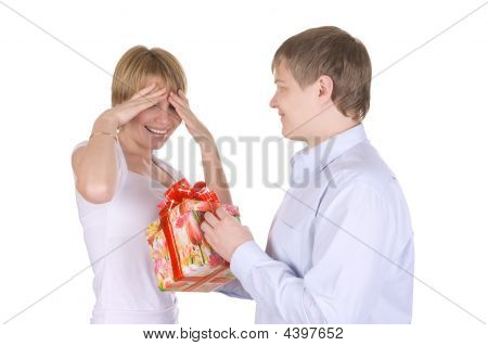 Happy Young Couple, Husband Does A Gift To The Wife.
