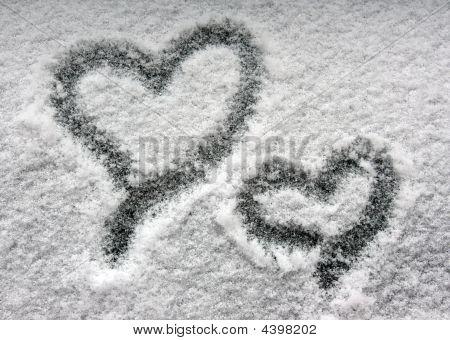 Two Hearts On Snowy Window