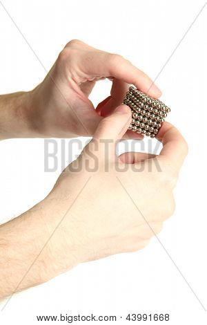Neocube (toy) in man hands, isolated on white