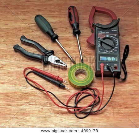 Electrician Tools On Wooden Surface