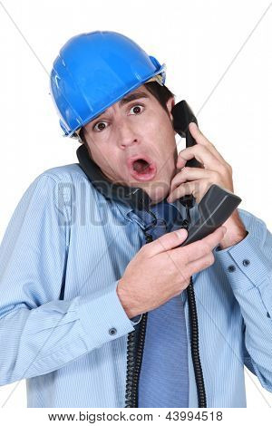 Stressed architect on the telephone