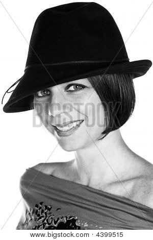 Smiling Brunette Girl In Black Hat
