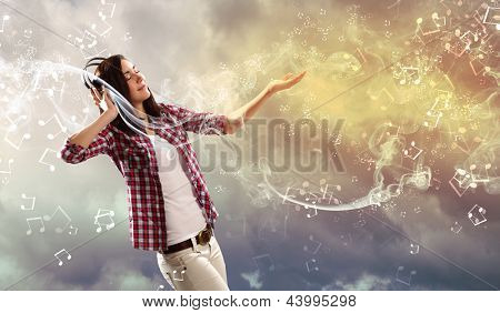 Young girl listens to music. Modulations of color and light.