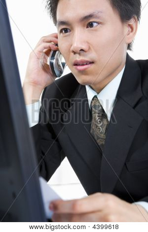 Young Asian Businessman On The Phone