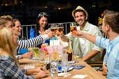 foto of marina  - Group of young friends drinking beer outdoors terrace night out - JPG