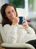 Happy Mature Woman Drinking Coffee, Indoors
