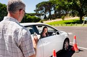 picture of seatbelt  - Learner driver girl with instructor taking lessons - JPG