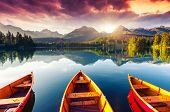 stock photo of sunrise  - Mountain lake in National Park High Tatra - JPG