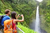 foto of waterfalls  - Couple tourists on Hawaii by waterfall - JPG