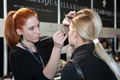 ZAGREB, CROATIA - MARCH 15: Fashion model prepares in backstage for Couture show by Marina Design on