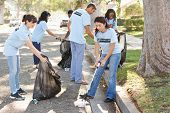image of pick up  - Team Of Volunteers Picking Up Litter In Suburban Street - JPG