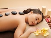 foto of beauty parlor  - picture of woman in spa salon with hot stones - JPG
