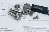 foto of vernier-caliper  - Vernier caliper and assorted screw nuts and bolts - JPG