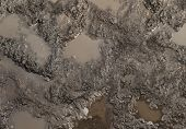 stock photo of rainy season  - Mud texture or wet brown soil with natural organic clay and geological sediment mixture as in rughing it in a dirty muddy country road bog after the rain or rainy season found in a damp moist climate - JPG