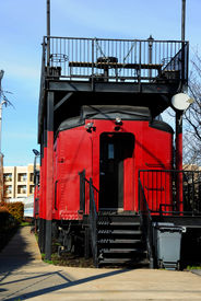 stock photo of caboose  - USC Cockaboose Railroad includes colorful caboose used for tailgating parties for USC football games - JPG