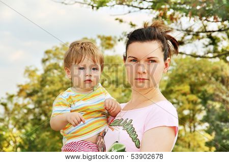 Mother And Child In The Park.