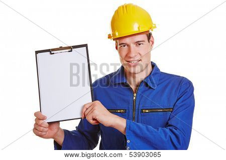 Construction worker showing a clipboard with empty white paper