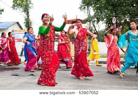 POKHARA, NEPAL-MAY 25. 2013: An unidentified Nepalese women dancing in traditional cloths during the nepal public holidey Buddha Jayanty on May 25, 2013 in Pokhara, Nepal.