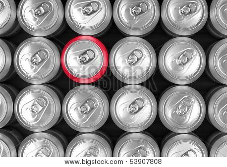 Aluminum drink cans and one red can.