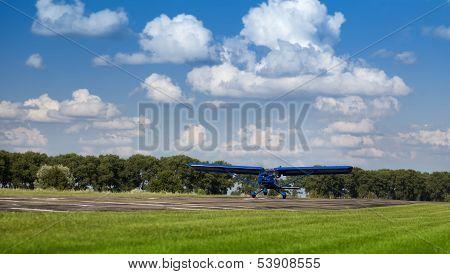 Blue two-seater mini plane