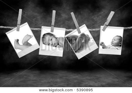 Black And White Photographs Hanging On A Rope By Clothespins