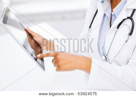 medicine, health and hospital concept - close up of female doctor working with tablet pc