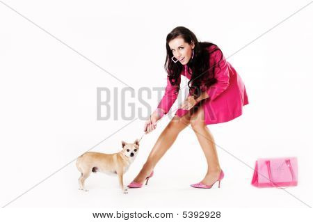 Young Sexy Woman Dressed In Pink Pulling Dog