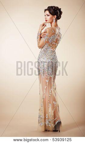 Fashion Studio Shot Of Elegant Woman In A  Evening Dress.