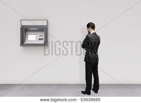 Man Looking At Atm