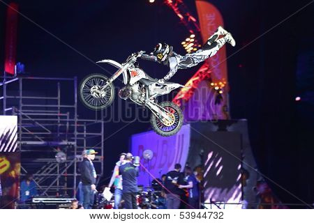 MOSCOW - MAR 02: Jump on a motorcycle with acrobatic elements on the festival extreme sports Breakthrough 2013, on March 02, 2013 in Moscow, Russia.