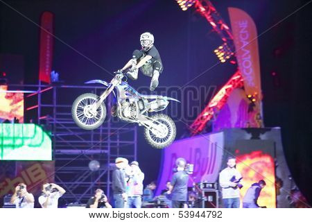 MOSCOW - MAR 02: Jump on a motorcycle with acrobatic stunts on the festival extreme sports Breakthrough 2013 in the arena of the Olympic Sports Complex, on March 02, 2013 in Moscow, Russia.