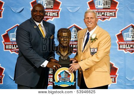 CANTON, OH-AUG 3: Former NFL player George Martin (L) and Bill Parcells pose with his bust during the NFL Class of 2013 Enshrinement Ceremony at Fawcett Stadium on August 3, 2013 in Canton, Ohio.