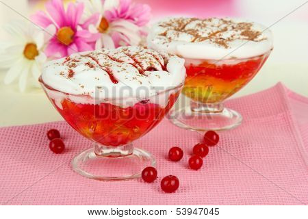 Tasty jelly in bowls on table on light background