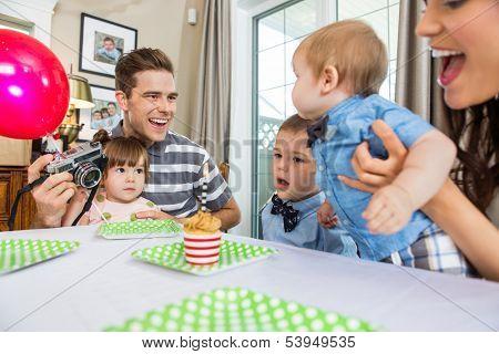 Happy family celebrating son's birthday at home